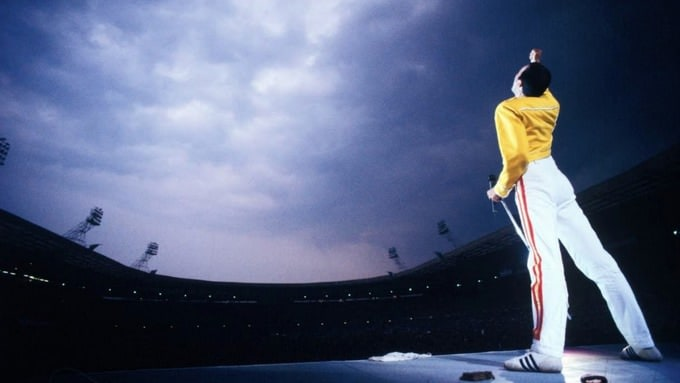 Picture of Freddie Mercury at Wembley Stadium. In his iconic yellow jacket. While performing a song. Films United produced a music video in 2019