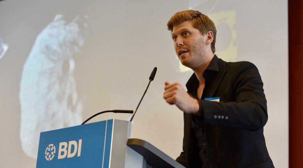 Grig Richters giving a speech at the BDI in Berlin, Germany.